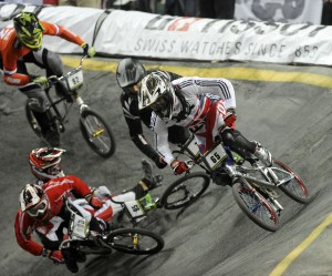 Mens elite world champion liam Phillips (GBR) leads the field out of turn one ahead of silver medalist Marc Willers (NZL) during ICU BMX World Championships at Vector Arena, Auckland, Sunday July 28, 2013. (Picture Ross Land)